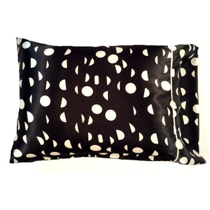 "This modern geometric design pillow is made from a black and white charmeuse satin print. The pillow feels ""down filled"" and is hypo-allergenic. The pillow and pillowcase are washable."