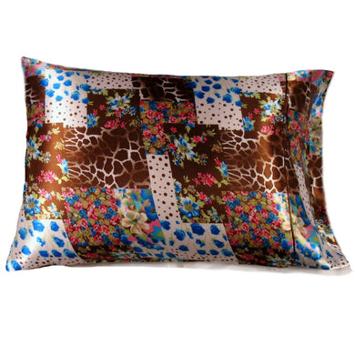 This pillow is made from a brown, white and blue giraffe satin print. The pillow feels