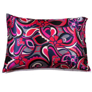 "This decorative pillow is made from a pink, black and purple geometric satin print. The pillow feels ""down filled"" and is hypo-allergenic. The pillow and pillowcase are washable."