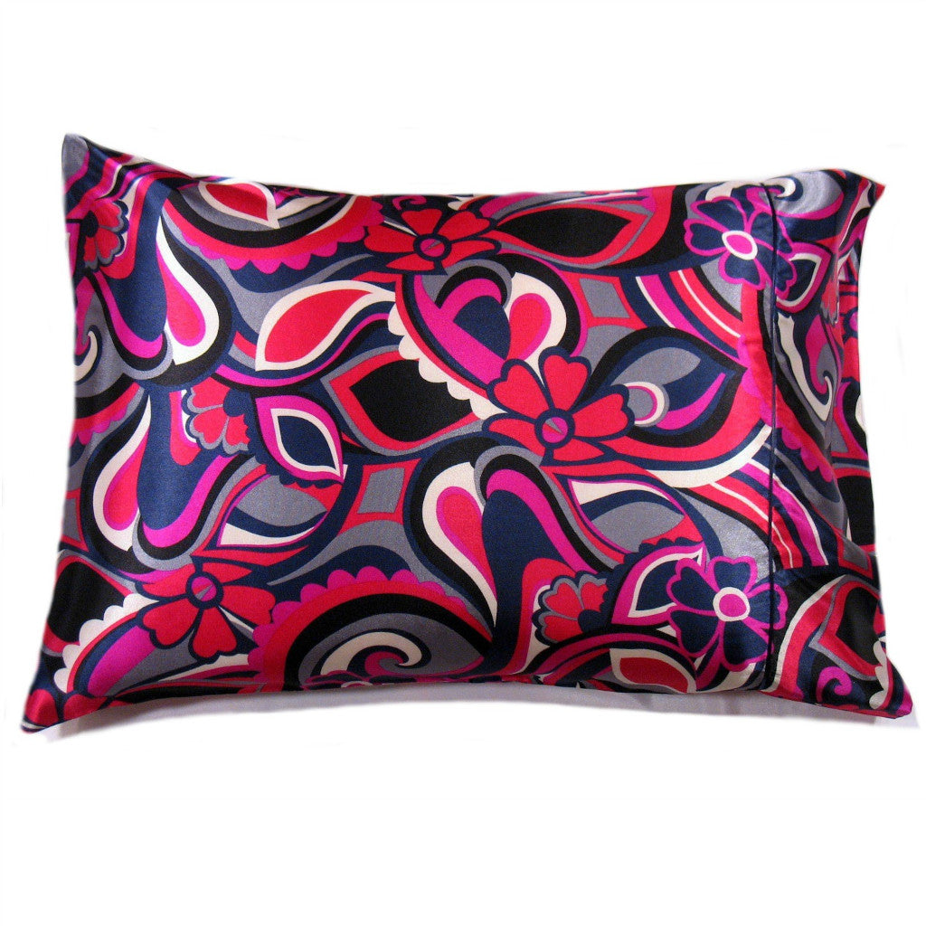 This decorative pillow is made from a pink, black and purple geometric satin print. The pillow feels