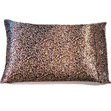 This decorative throw pillow is made from a brown and cream satin print. The pillow feels