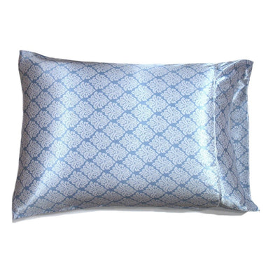 This travel pillow is made from a light blue and white charmeuse satin print. The pillow feels