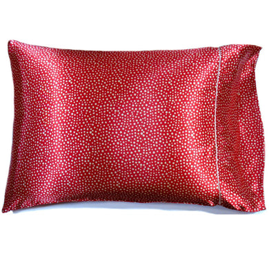 This sofa nap pillow is made from a rust with white polka dots satin print. The pillow feels