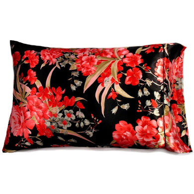 This designer pillow is made from a beige, black, green and orange satin print. The pillow feels