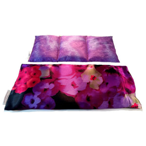 Pink and purple flowers hot/cold therapy wrap. A washable satin cover with a cotton insert. Three sections filled with organic flaxseed. Microwaveable.