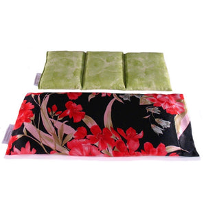 Hot/cold therapy wrap. A washable black with red flowers satin cover with a cotton insert. Three sections filled with organic flaxseed. Microwaveable.