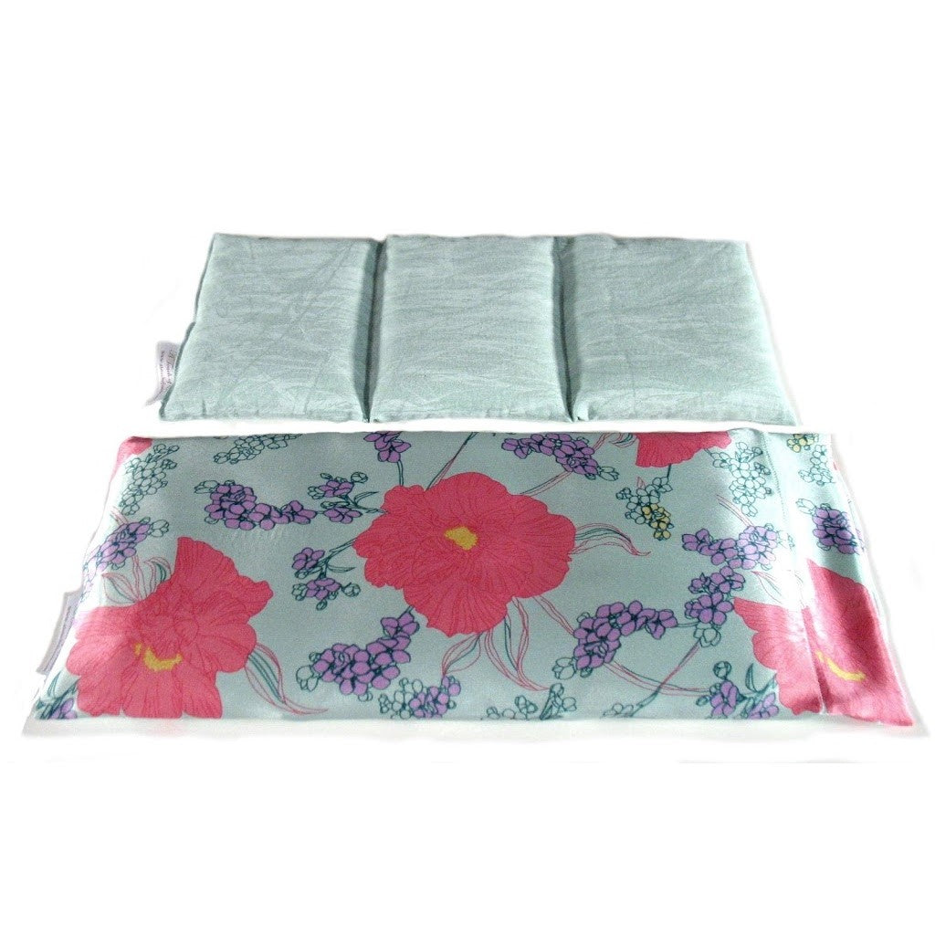 Hot/cold therapy wrap. A washable mint green with pink flower print satin cover with a cotton insert. Three sections filled with organic flaxseed. Microwaveable.