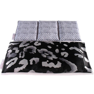 Cooling therapy wrap. A washable black and gray print satin cover with a cotton insert. Three sections filled with organic flaxseed. Microwaveable.
