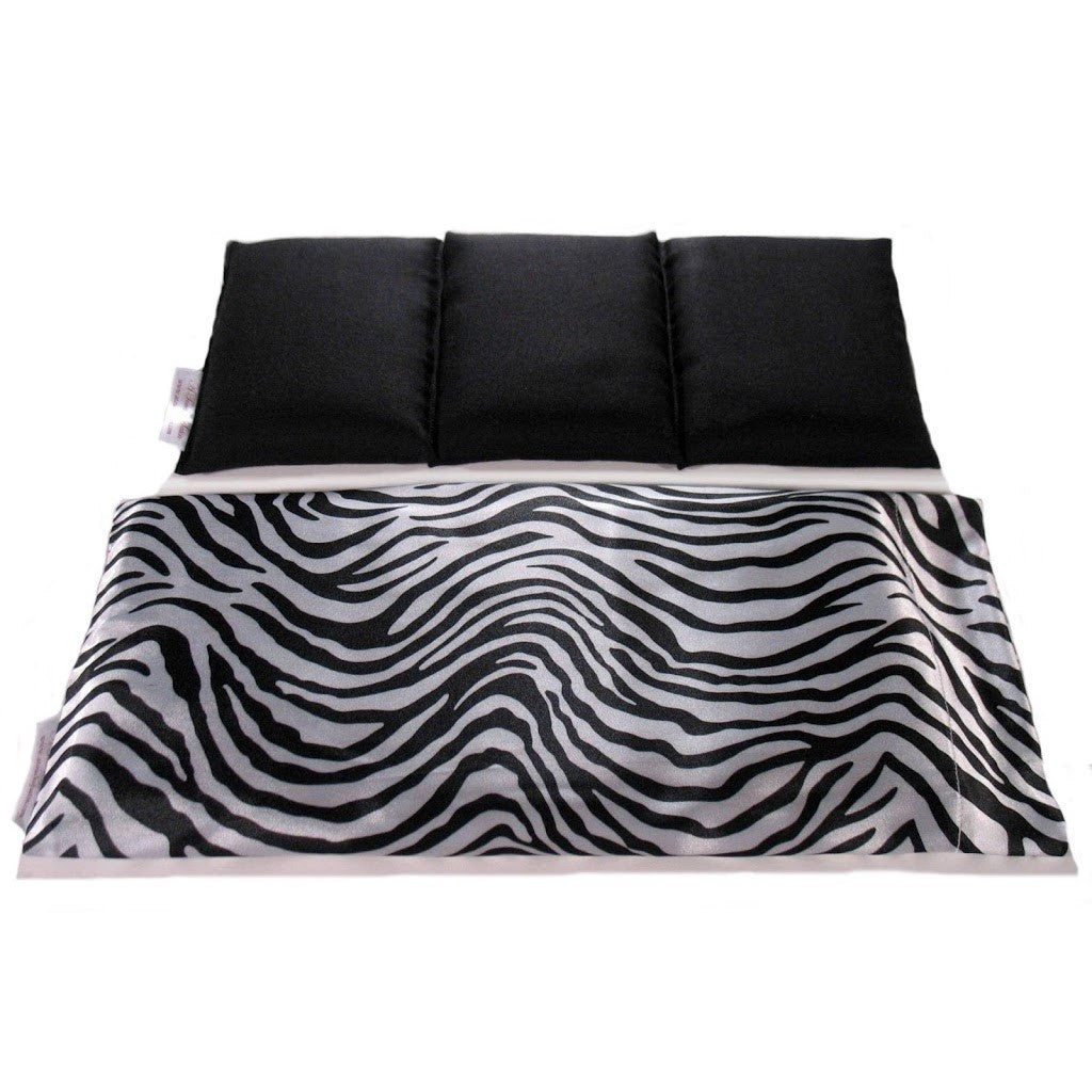 Hot/cold therapy wrap. A washable zebra print  satin cover with a cotton insert. Three sections filled with organic flaxseed. Microwaveable.