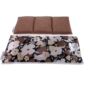 Natural pain remedy wrap. A washable brown and white flowers print satin cover with a cotton insert. Three sections filled with organic flaxseed. Microwaveable.
