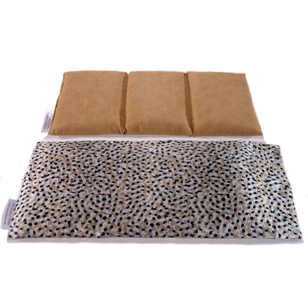 Microwave heating pad. A washable black and tan satin cover with a cotton insert. Three sections filled with organic flaxseed.