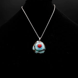 Jewelry - Sky blue and mahogany patterned pendant with red dot