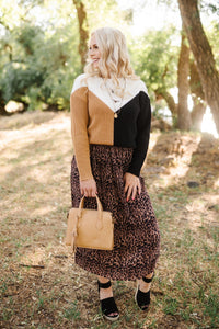 We See The Magic Pleated Animal Print Midi Skirt