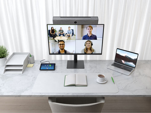 video conference meeting with neatbar video soundbar, neatpad zoom room controller and mointor display