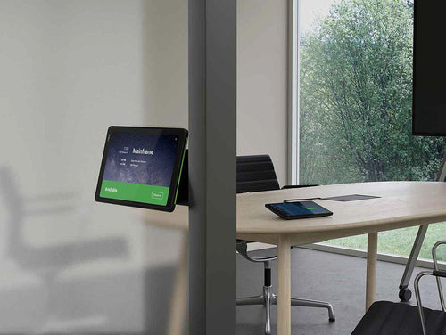 neatpad being used as a zoom room controller and zoom room scheduling display in a modern video conference meeting room