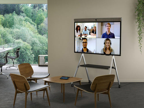 zoom rooms neatboard interactive digital whiteboarding with video soundbar built-in in a modern office with neatpad zoom rooms controller and scheduling display in a modern huddle space neatboard is on a stand
