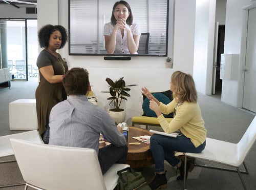 video conferencing meeting in modern office with video soundbar and collaboration