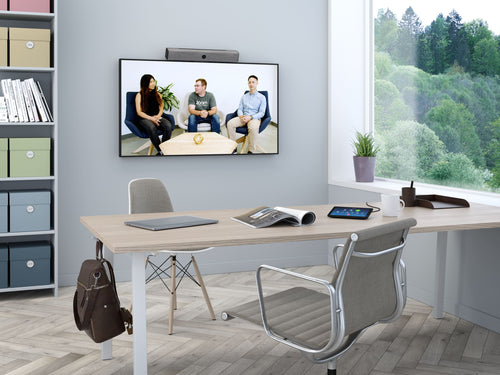 neat bar vidoe sound bar tv display neat pad zoom rooms controller in a modern office for video conference meetings
