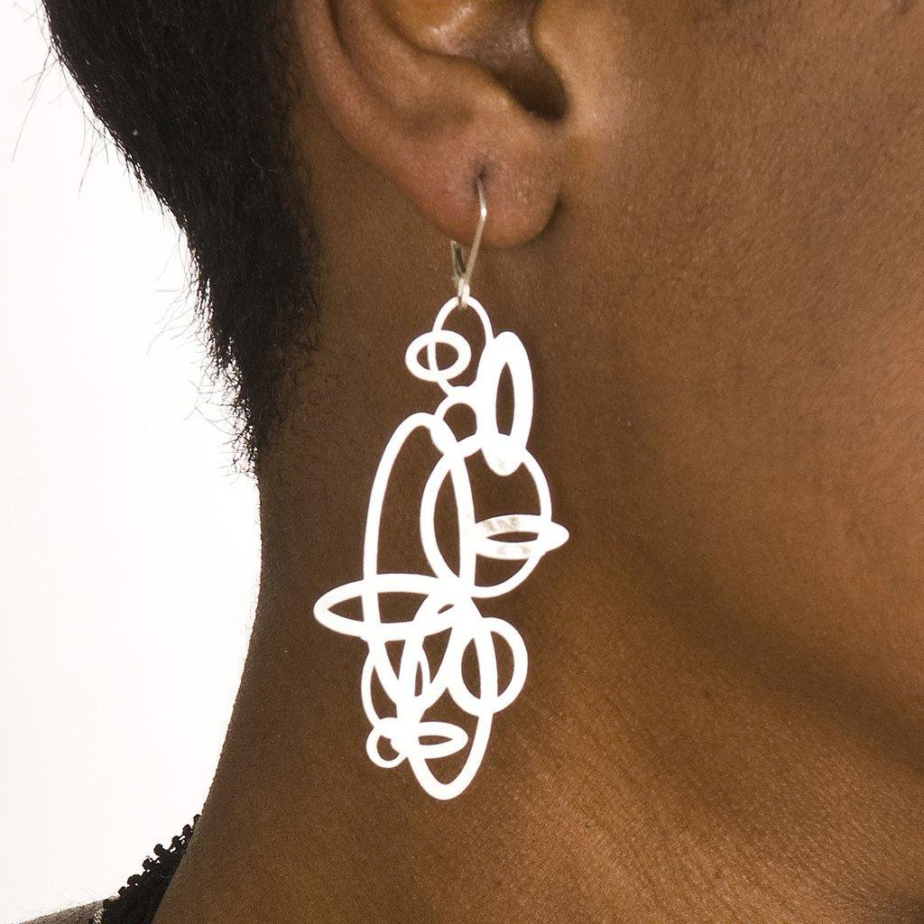 model wearing circles Pop-Out Jewelry in silver