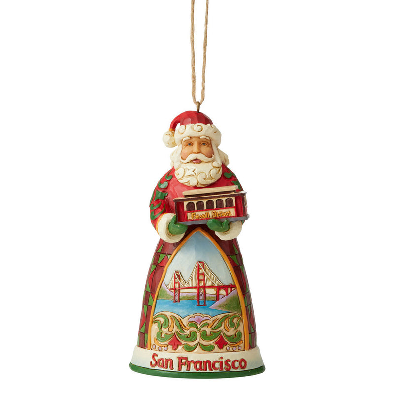 Jim Shore San Francisco Santa Ornament holding a cable car with hand painted Golden Gate Bridge on front 4.5""