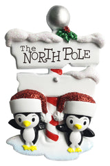 Penguin Couple North Pole Ornament
