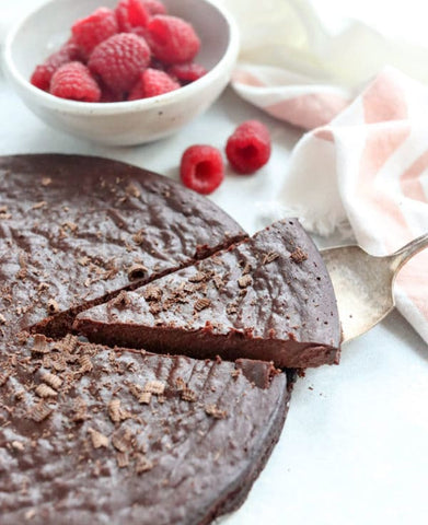 Revved Up Hot Sauce is great for any chocolate dessert. Easy chocolate recipes. Image description: homemade flourless chocolate cake