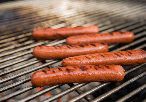 Spice up your hot dog recipe with spicy cayenne. Pictured: grilled hot dogs on the barbecue