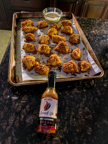 Easy oven baked chicken breast popcorn chicken recipe with hot sauce that you're going to love image- with