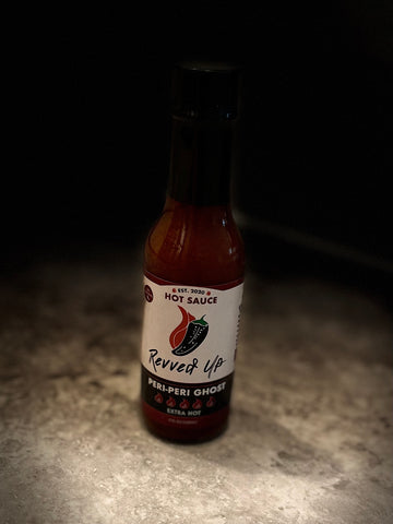 Revved Up Peri-Peri Ghost Pepper Hot Sauce has a sweet, spicy flavor that works perfectly in chocolate desserts. Product Image.