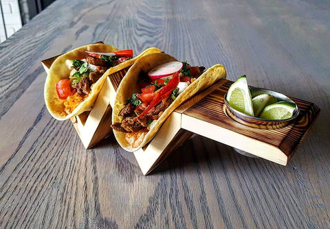 Fun Taco Party Ideas. Pictured: Wooden taco holder with lime wedges