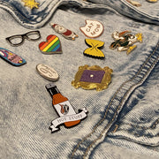Hot Stuff soft enamel pin on a denim jacket, from a pin collector customer. This hot sauce pin is a spicy way to show off your favorite condiment. Available exclusively here at Revved Up!