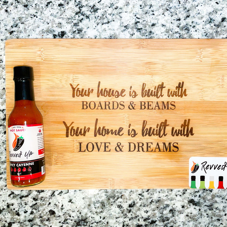 Spicy Cayenne Bomb Hot Sauce - | Revved Up. Your house is built with boards and beams. Your home is built with love and dreams. Cutting board design with hot sauce on it.