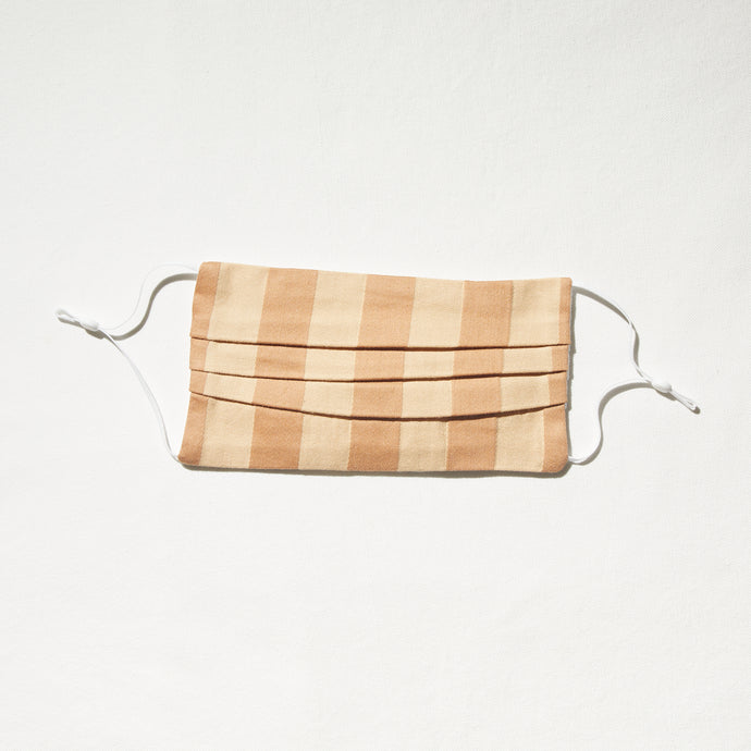Cream and tan broad striped mask with adjustable straps and nosewire for optimal fit