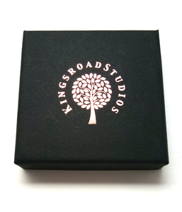 Presentation Box with copper foil Kingsroad Studios logo  Edit alt text
