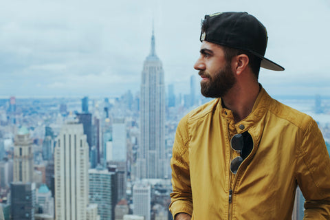 Bearded man with Yellow Jacket and Hat photo by Omar López from Pexels