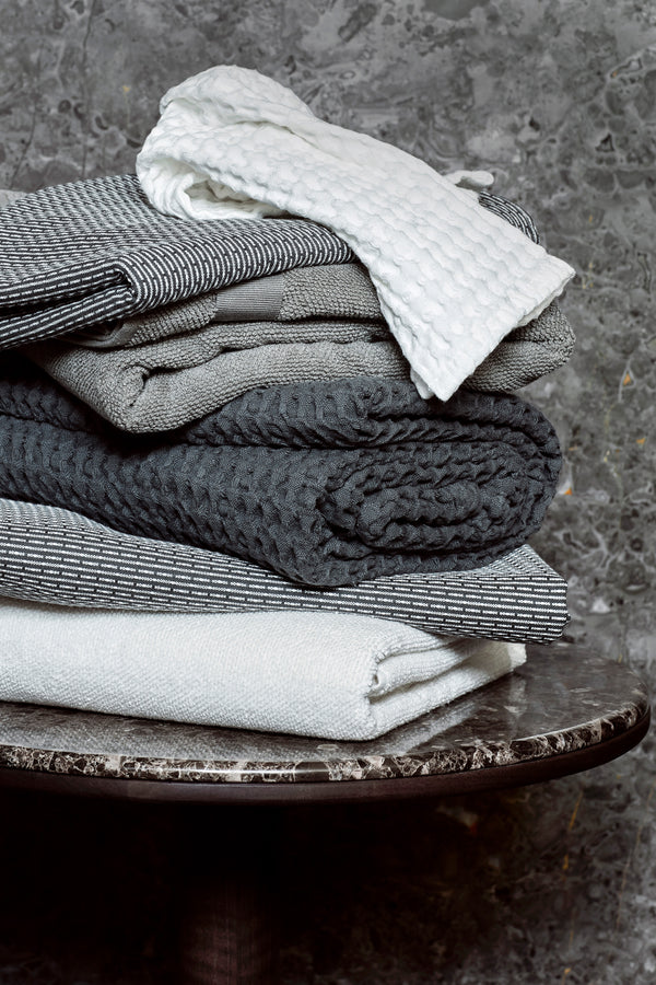Stack of towels in different shades of grey