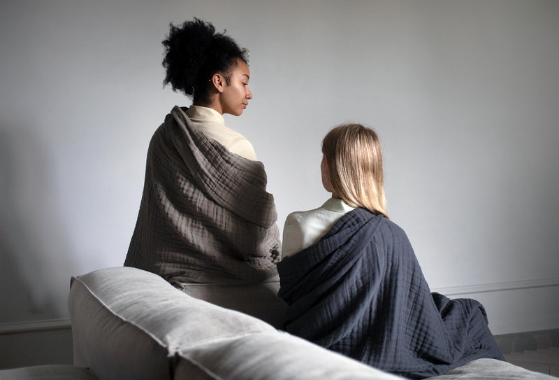 2 women wrapped in blankets