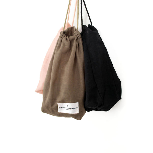 3 bags in the colours black, brown and pink hanging