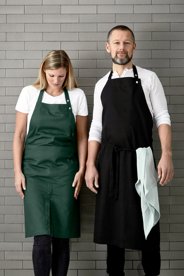 Man and woman wearing long aprons