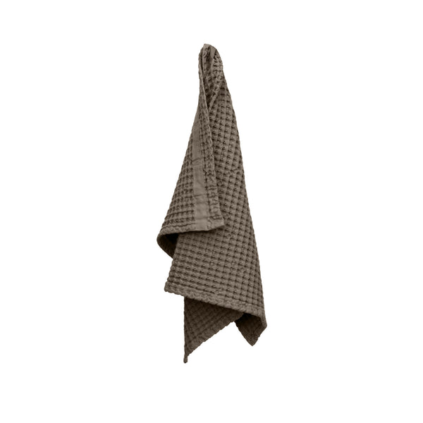 Brown organic towel hanging