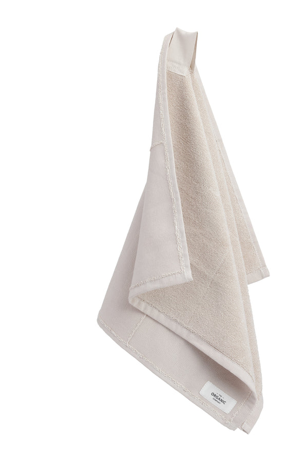 Beige towel hanging