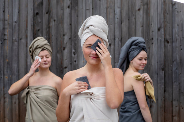 Three women in gots certified organic towels using reusable makeup pads