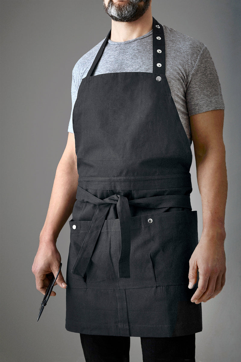 Man wearing black apron for gardening