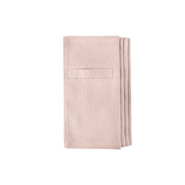Rose colored napkins folded