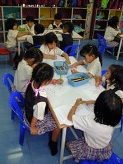 Barry's class in Thailand, colouring in the Advent Calendar