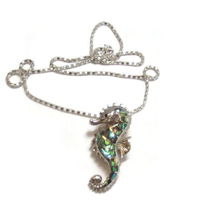 Sea Horse Sterling Silver Pendant/Brooch and chain inlaid with Paua shell.
