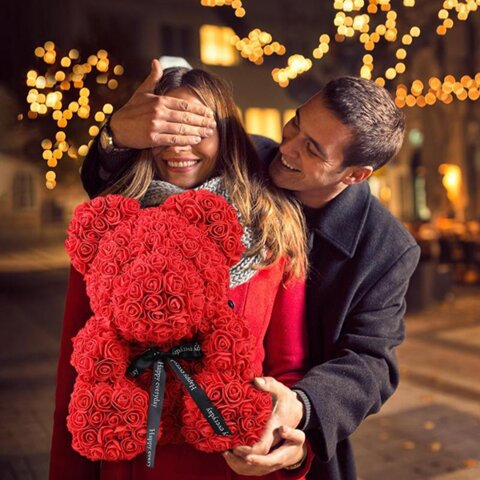man is about to surprise his woman with handmade rose teddy bear gift