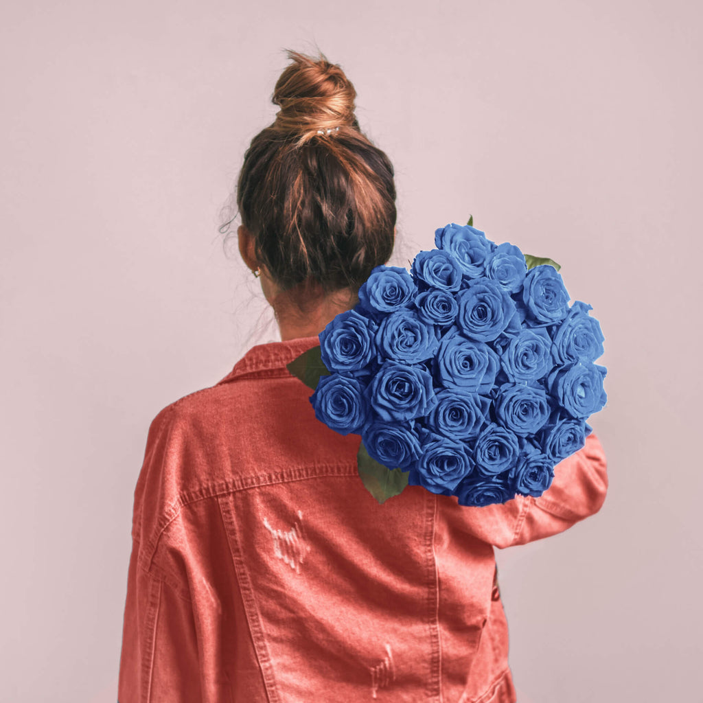 woman holding blue roses