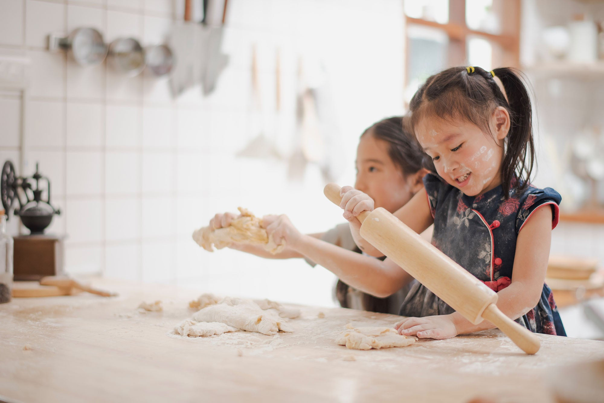 Kids playing with flour and dough in the kitchen