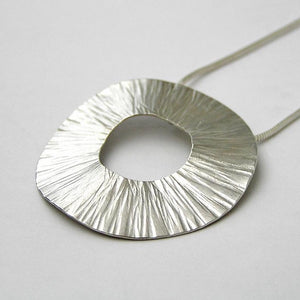 Radiant silver pendant by Anna K Baldwin